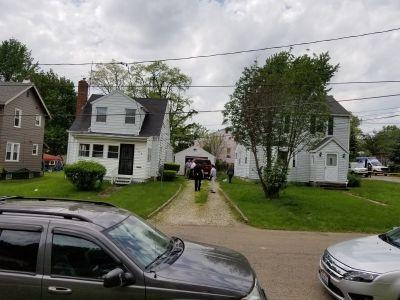 Authorities search two nearby houses in connection to fire that killed 7, Akron police say