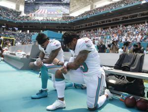 The Latest: Lightning suspends play between Titans-Dolphins