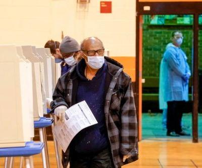 Pandemic politics: Wisconsin voting underway despite coronavirus concern