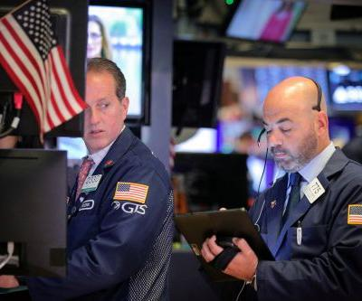 Stocks end mixed as trade tensions weigh on Wall Street
