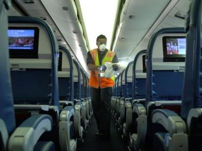 A Delta flight attendant describes what it's like flying during the coronavirus pandemic with near-empty planes and 'ghost town' airports
