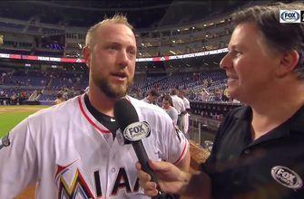 Bryan Holaday talks with Craig Minervini after his walk-off hit