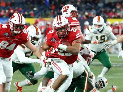 Jonathan Taylor helps Wisconsin Badgers batter Miami Hurricanes in Pinstripe Bowl