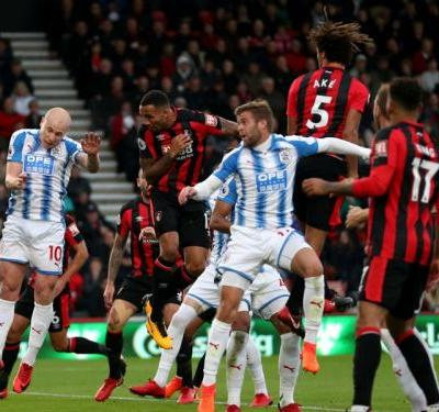 Bournemouth 4 Huddersfield Town 0: Hat-trick hero Wilson stars for 10-man Cherries
