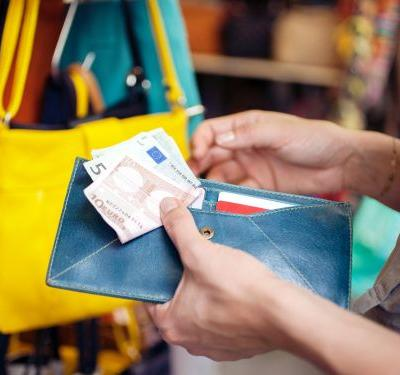 How to pay for purchases on European trips - we break down the pros and cons of using cash, credit cards, and debit cards