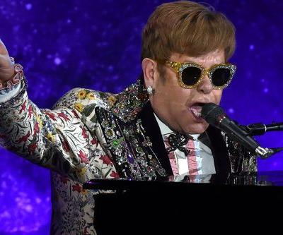 Elton John nailed in the face with Mardi Gras beads