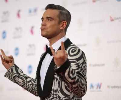 Robbie Williams Wins 4-Year Battle With Jimmy Page To Build A Swimming Pool In His House