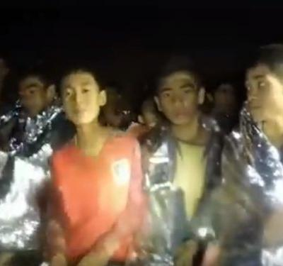 The coach who led the 12 children on a Thai soccer team into an underground cave is likely to 'not face criminal charges,' Thai legal experts say