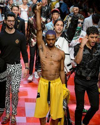 Dolce & Gabbana model stages protest at men's show