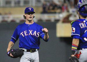 Hamels throws complete game No. 16 as Rangers beat Twins 4-1
