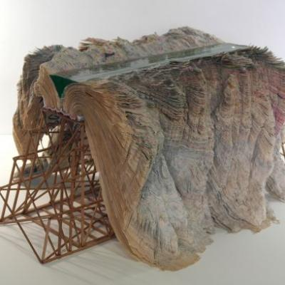 Old Books Become Craggy Mountains and Waterway Channels in Otoniel Borda Garzon's Mixed Media Sculptures