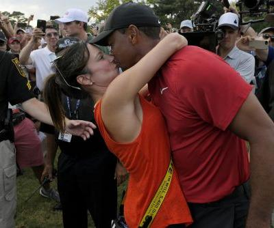 Tiger Woods seals victory with 'love you' and kiss for girlfriend