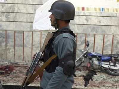 Afghan officials: Taliban attacks kill 14 troops, policemen
