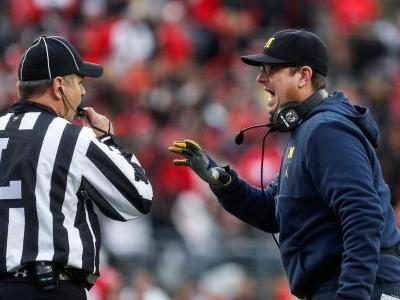 Jim Harbaugh shoots down NFL rumors: 'I'm staying at Michigan'
