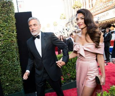 George and Amal Clooney are donating $100,000 to help migrant children