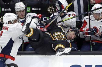 Benched! Caps' Ovechkin flips 6-foot-9 Chara over boards