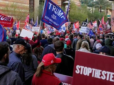 Arizona certifies Biden's win as Trump's legal team holds an event in the state over the president's baseless claims of voter fraud