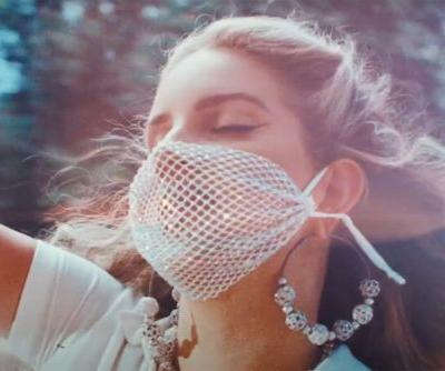 Lana Del Rey rewears mesh mask in 'Chemtrails Over the Country Club' video