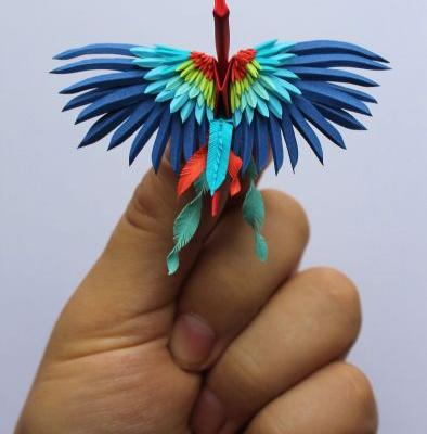Elegant Paper Cranes Composed of Detailed Cuts, Folds, and Flowers