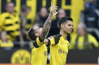 Dortmund win as Alcacer gets hat trick with game's last kick