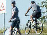 Obama takes a bike ride with security team in Tuscany