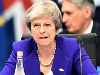 Theresa May under pressure to delay Brexit vote as leadership rivals circle