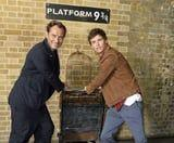 All Aboard! Jude Law and Eddie Redmayne Surprised Fans at Kings Cross Station