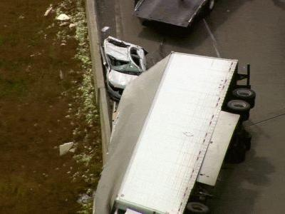 Driver flown to hospital after tractor-trailer rolls over onto his vehicle