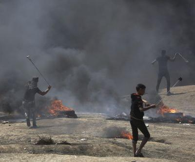 More than a dozen killed during mass protests on Gaza border