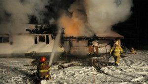 Dogs credited for alerting family to burning SW MI home