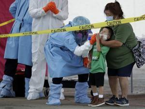 Virus tests hospitals in pockets of US as some states reopen