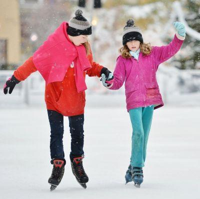 Skaters embrace the season's first snowfall as Lock 3's rink opens