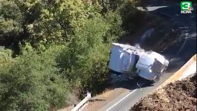'Multiple signs are posted to warn truck drivers': Video shows big rig taking scary tumble off highway