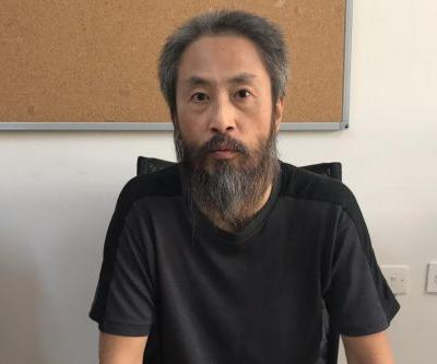 Japanese journalist returns to Tokyo after he's freed from Syria