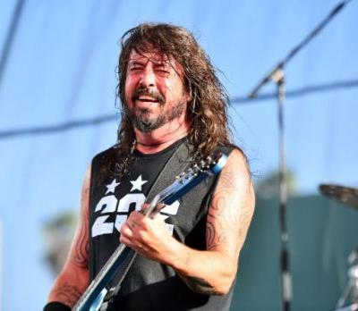 Watch Dave Grohl Fall Off The Stage In Vegas After Chugging A Beer