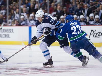 Canucks' Alex Edler leaves game vs. Jets with lower-body injury