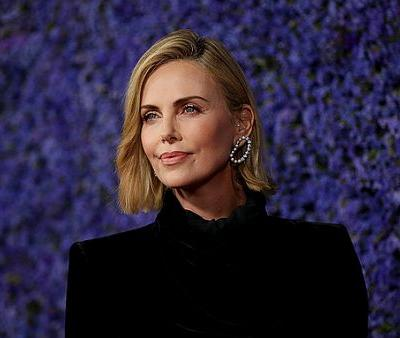 Inside Charlize Theron's $1000 Daily Skin and Hair Care Regime