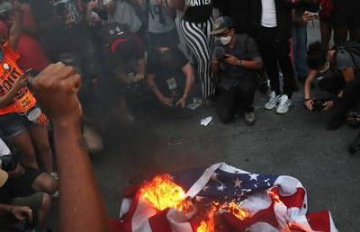 'F*ck the American flag': WATCH BLM protesters stomp on & BURN US flag outside White House