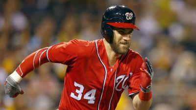 Watch: Nationals Bryce Harper carried off field with apparent knee injury