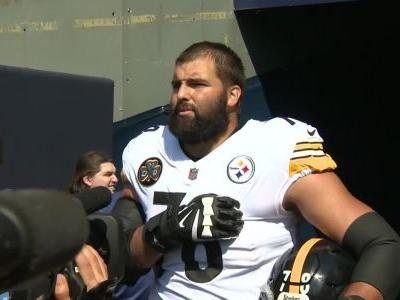 Alejandro Villanueva stands outside of Steelers tunnel during National Anthem