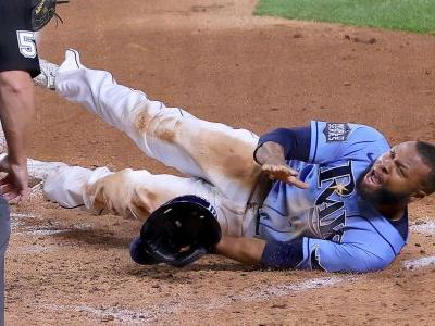 Rays' Manuel Margot tries to steal home in Game 5 of the World Series
