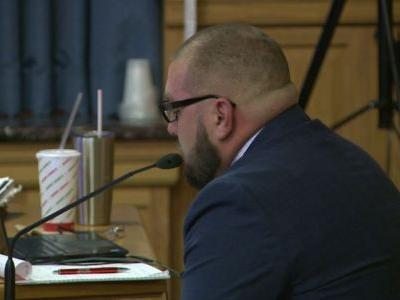 Officer fired for Facebook posts delivers emotional testimony