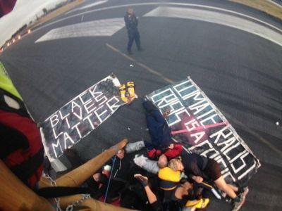 Black Lives Matter storm runway at London City Airport