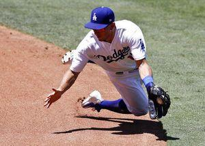 Dodgers win 10th in row, beat Rockies 12-6; Bellinger 2 HRs