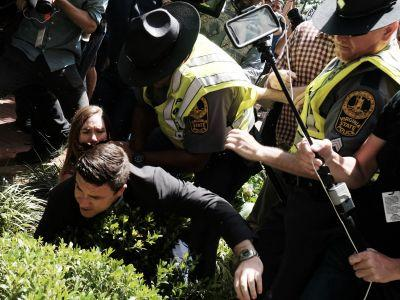 """Protesters chased """"Unite the Right"""" rally organizer Jason Kessler out of his own press conference"""