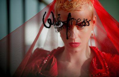 Dressing up as a red Margiela bride for the Met Gala
