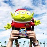 Santa-Themed Alien Popcorn Buckets Have Invaded Disney World, and They're Absurdly Cute