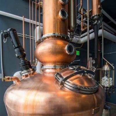 This Zero-Waste Distillery Invites You to Sleep it Off on Designer Sheets