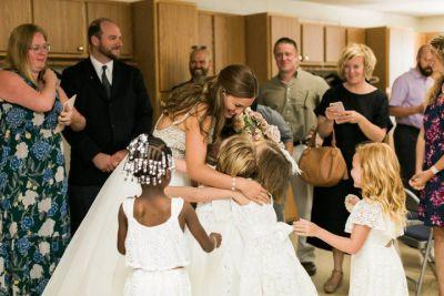 Teacher gets walked down the aisle at her wedding by 20 of her students