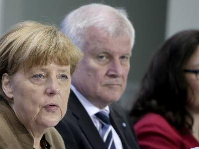 Germany's Merkel: gov't must give up internal disputes